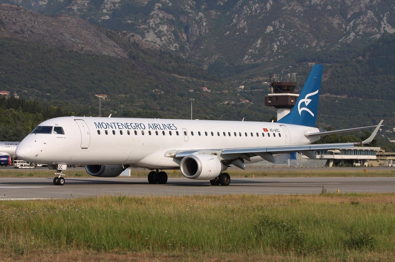 Montenegroairlinesov embraer E 195 na aerodromu Tivat